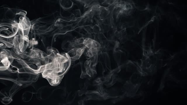 white smoke isolated on black - fumo materia video stock e b–roll