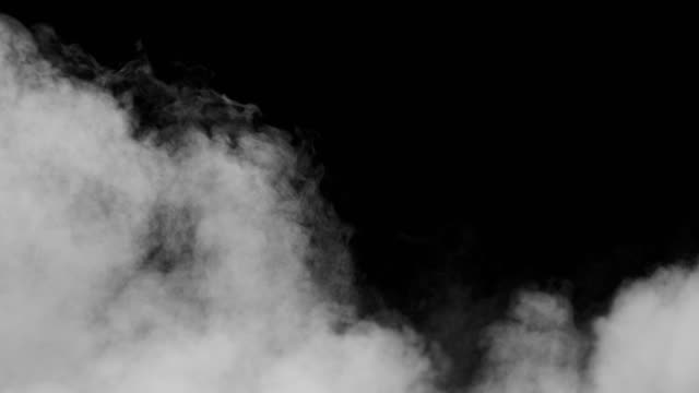 White Smoke on Black Background White clouds of vapor smoke are isolated on a black background. Gas explodes, swirl and dances in space. A magic fog dust texture effect that can be used by overlay and changing their transparency. steam stock videos & royalty-free footage