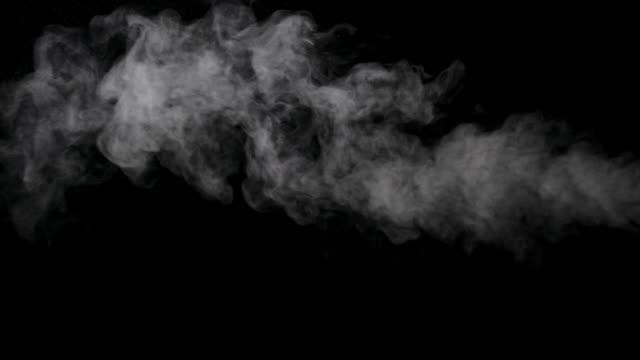 white smoke trail isolated on black background - traccia video stock e b–roll