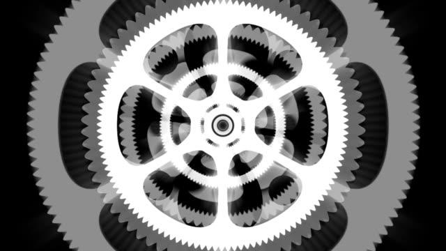 white spinning gears loop on black background - wheel black background bildbanksvideor och videomaterial från bakom kulisserna