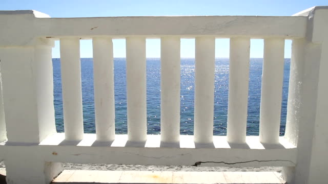 white stairs that lead to the perfect blue sea and beach. summer view with classic white balustrade and empty terrace overlooking the sea. travel, swimming, summertime, mediterranean, adriatic sea. - balaustrata video stock e b–roll