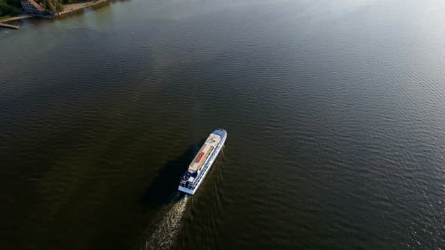 white steamship in the middle of the southern bug from a bird`s eye perspective - pentola a vapore video stock e b–roll