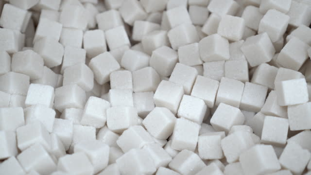 White sugar cubes close up panorama on a background of refined 4K for your text.