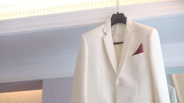 White suit hanging ready for the wedding