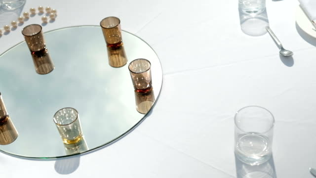 white table with drinks on mirror for banquet on fresh air outdoors video