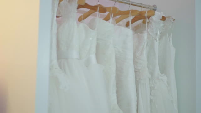 White Wedding Dresses on Hanger in the Store video