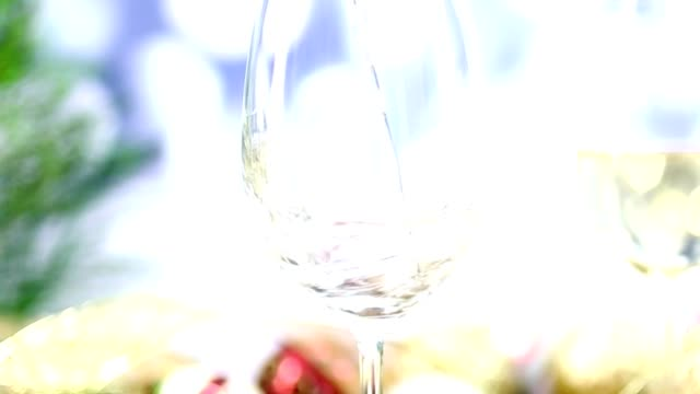 White wine and falling snow at Christmas party. video