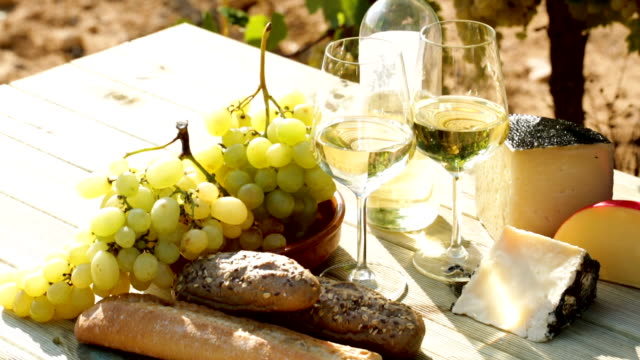 white wine, grapes and cheese against vineyard landscape Picturesque still life – white wine, grapes and cheese against vineyard landscape provence alpes cote d'azur stock videos & royalty-free footage