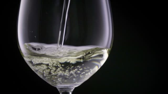 White wine poured in a glass video