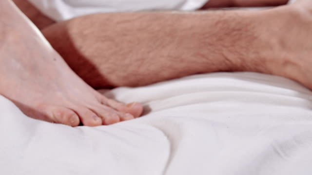 white woman foot wih a mole on white blanket in sex scene White couple have sex on a bed, detail, close up sexual activity sex naked couple stock videos & royalty-free footage