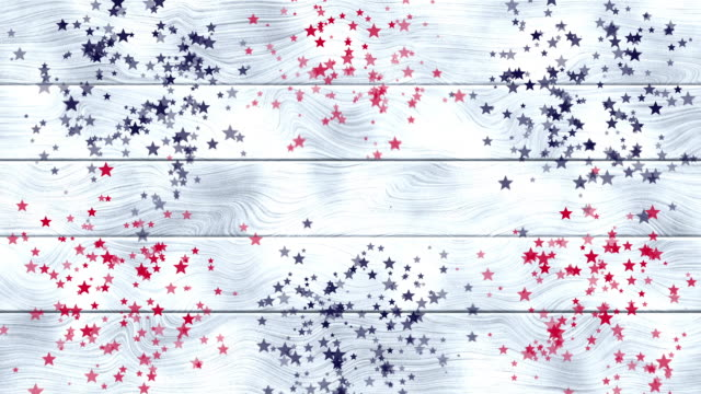 white wooden background with red, blue stars fireworks or confetti for usa national holiday celebration. 4th of july. american independence day. veterans or labor day. memorial day. animation - veterans day filmów i materiałów b-roll