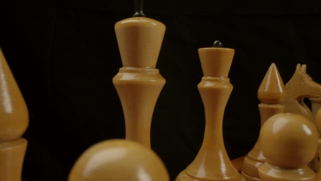 White wooden chess pieces in start game position waiting for epic battle