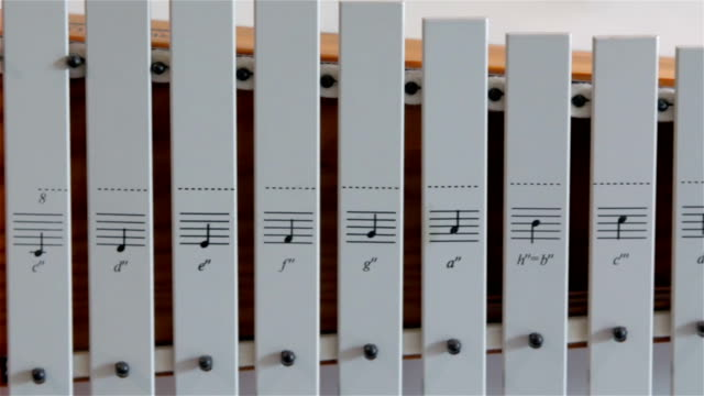 A white xylophone found inside the Orel church video
