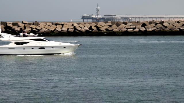 White yacht cruises near the beach of Hague video