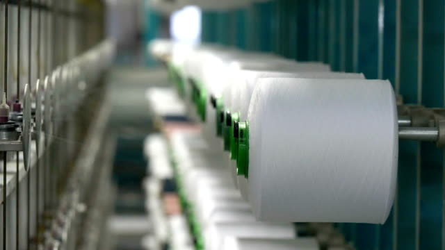 White yarn spools of industrial  warping machine  in textile factory