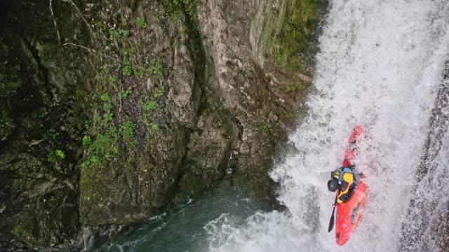 slo mo whitewater kayaker running a nice waterfall - niebezpieczeństwo filmów i materiałów b-roll