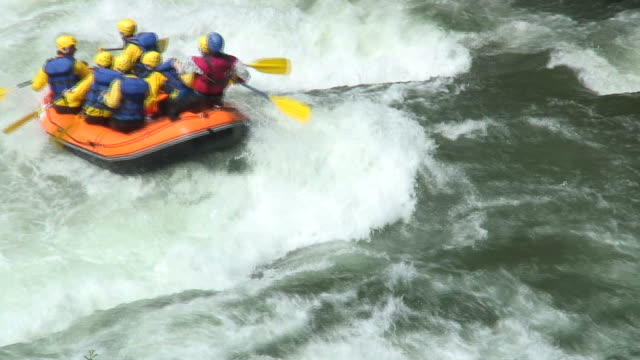 Whitewater rafting HD 1080i: Rafting boats on a whitewater river. Tripod. Sound. rapids river stock videos & royalty-free footage
