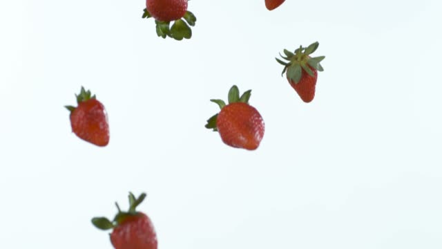 vídeos de stock e filmes b-roll de who needs candy when nature's full of it? - strawberry