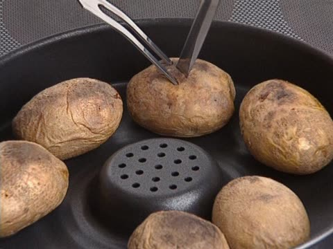 Whole potatoes backed in pan video