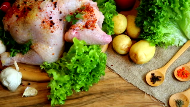 Whole raw chicken with vegetables video