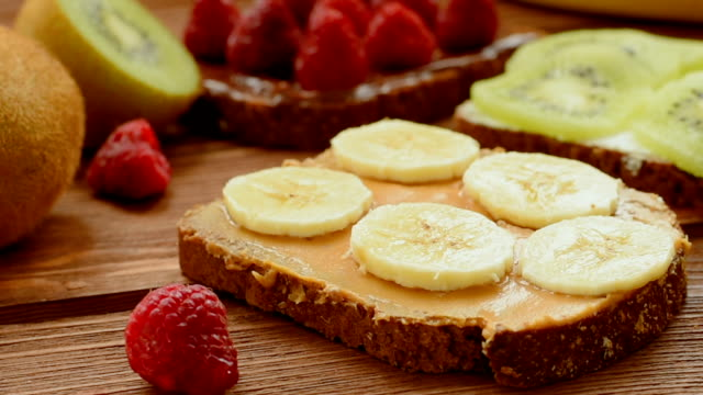 Whole wheat bread with fruits and berries for breakfast video