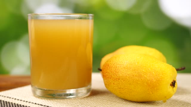 Whole Yellow Pear and Juice in Glass