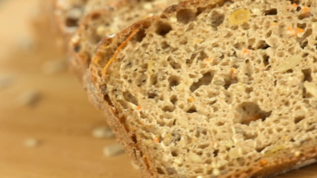 Wholegrain rye bread with seeds on a wooden board video