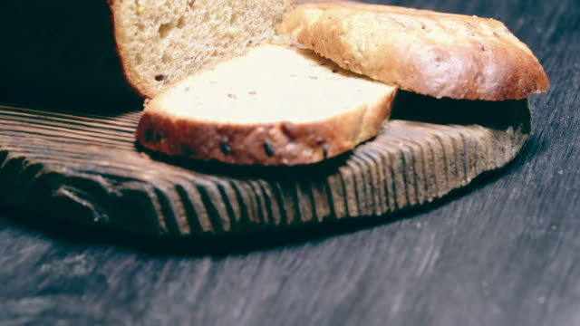 Wholemeal bread on rustic wood video