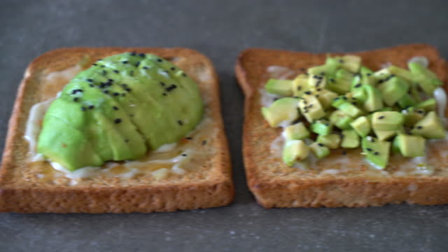 wholewheat bread toast with avocado - vegan stock videos and b-roll footage
