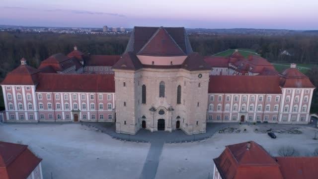stockvideo's en b-roll-footage met wiblingen kloster abdij met drone bij zonsopgang - klooster