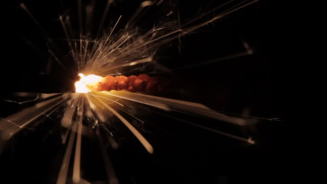 Wick Sparks Fuse sparks go through the frame, like in the impossible missions of the spy movies. You can use it like background for your titles. This video has a black background so you can blend it easily by screen mode in your footage or use it to do a third lower or transition. Also you can change the velocity of the sparks. action movie stock videos & royalty-free footage