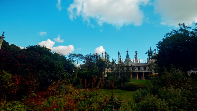 wide angle panning shot of the royal pavilion in brighton, england, uk on a sunny day - victorian architecture stock videos & royalty-free footage