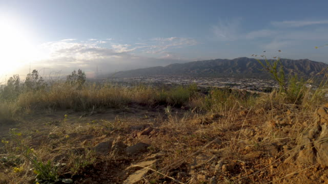 Wide angle shot from peak above Burbank, CA at sunset video