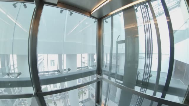 wide angle view of elevator interior with glass walls pov - szerokokątny filmów i materiałów b-roll
