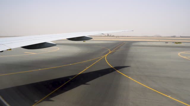 Wide area for take-off and landing strips. Runway covered with yellow markings Wide area for take-off and landing strips. Runway covered with yellow markings. airfield stock videos & royalty-free footage