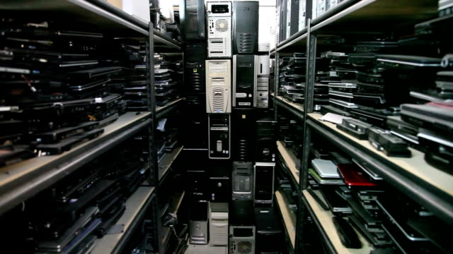 Wide dolly shot of old computers. Wide dolly shot of old computers. mainframe stock videos & royalty-free footage