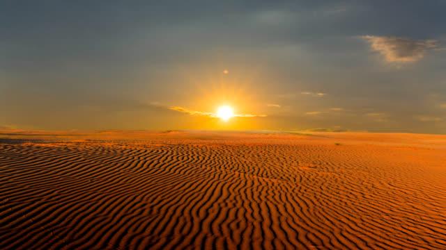 wide hot sandy desert at the sunset, wildlife timelapse scene