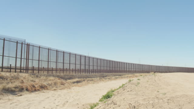 Wide Pan of Border Fence video