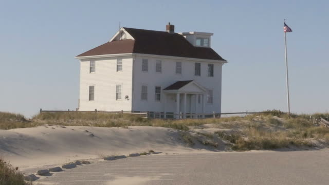 Wide pan of the Ranger Station, on a windy day, in the Cape Cod National Seashore, in Provincetown, MA. video