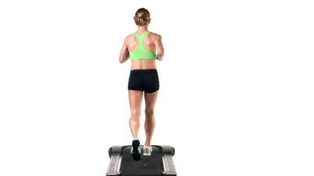 Wide shot of a female running in place on a treadmill Wide shot of a female running in place on a treadmill human joint stock videos & royalty-free footage