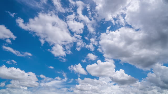 T/L Wide Shot Of Clouds Moving Over Blue Sky in Chiang Mai, Thailand