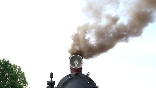 Wide shot of historic retro steam train top with smoke going right Wide shot of historic retro steam train top with smoke going right railroad station platform stock videos & royalty-free footage