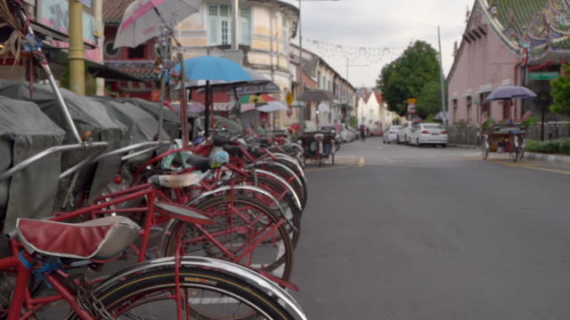 Wide shot of Parked red trishaws in Penang, Malaysia