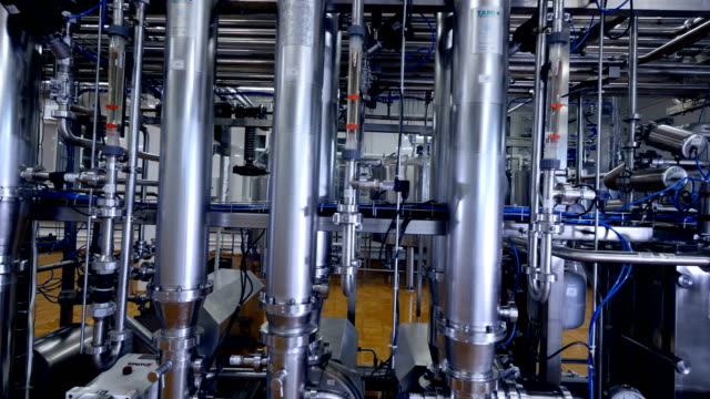 Wide vertical pipes at a dairy factory. video