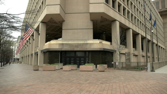 wide view of the exterior of the fbi building in washington, d.c. - quartiere generale video stock e b–roll