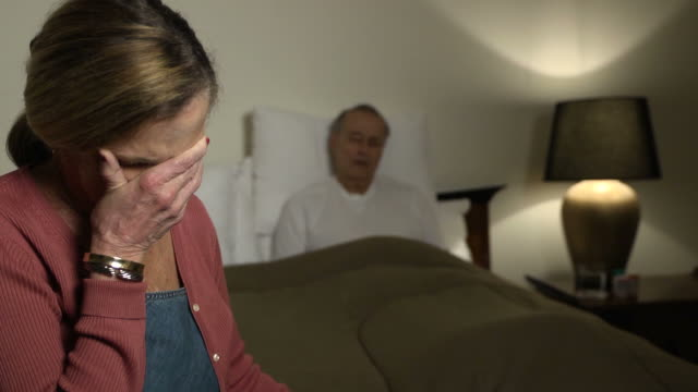 wife expresses concern for sick husband - ws - senior care stock videos and b-roll footage