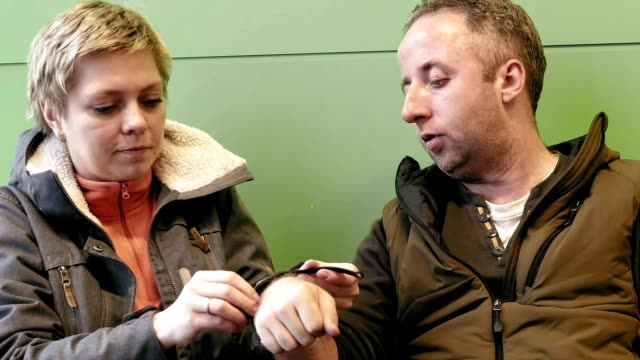 Wife helps her husband to take on watch with love video