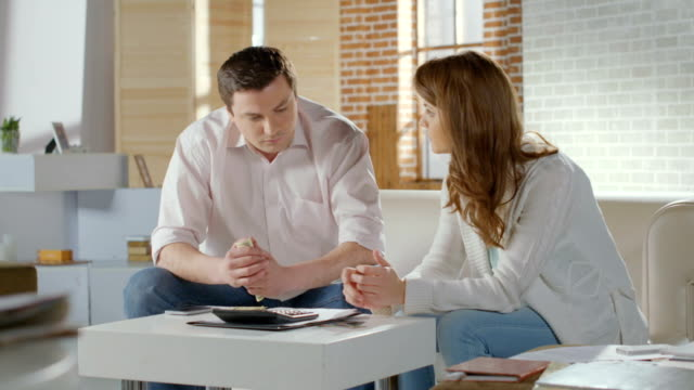 Wife husband planning family budget, finances, going bankrupt video