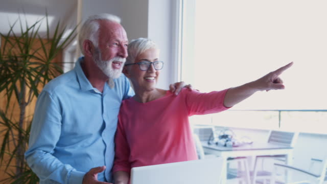 wife showing husband next real estate - baby boomer stock videos and b-roll footage