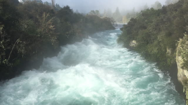 Wild rushing stream of Huka Falls Taupo New Zealand Wild rushing stream of Huka Falls near Lake Taupo in the North Island of New Zealand rapids river stock videos & royalty-free footage